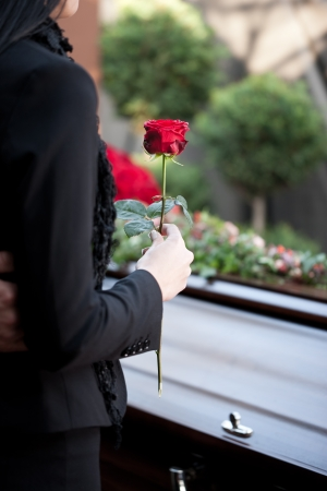 coffin: Religion, death and dolor  - funeral and cemetery; funeral with coffin Stock Photo