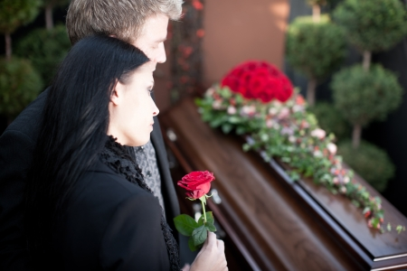 sadness: Religion, death and dolor  - funeral and cemetery; funeral with coffin Stock Photo