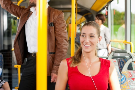 Female passenger in a bus; presumably she is heading home photo