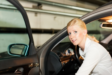 woman is getting into her car in the parking garage Stock Photo - 11529516