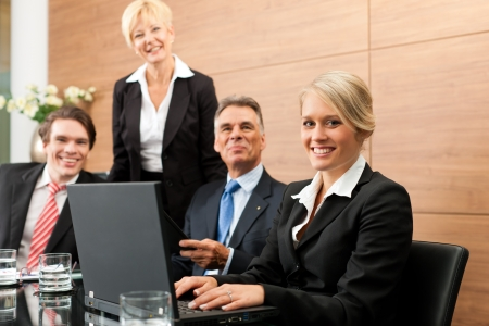 lawyer meeting: Business - team meeting in an office with laptop, the boss with his employees
