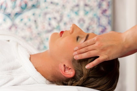 stress relief: Wellness - woman getting massage or facial in Spa; it is a massage for the head