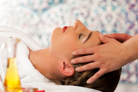 Wellness - woman getting massage or facial in Spa; it is a massage for the head Stock Photo - 11530201