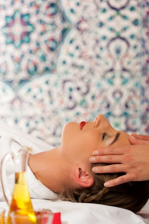 Wellness - woman getting massage or facial in Spa; it is a massage for the head Stock Photo - 11530239