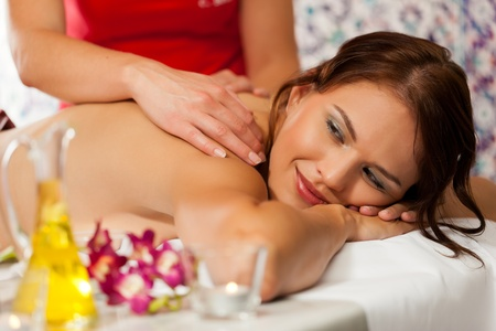 Wellness - woman getting massage in Spa; it is a traditional back massage Stock Photo - 11530248