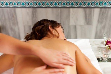 Wellness - woman getting massage in Spa; it is a traditional back massage Stock Photo - 11530199