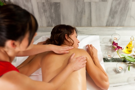 Wellness - woman getting massage in Spa; it is a traditional back massage Stock Photo - 11530184