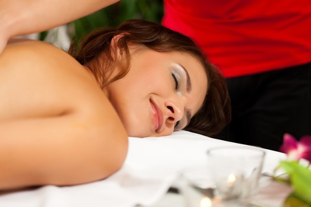 Wellness - woman getting massage in Spa; it is a traditional back massage Stock Photo - 11530185