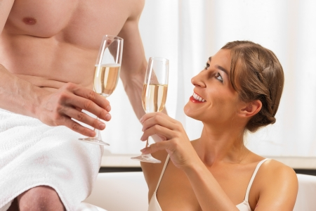 getaways: Couple is doing wellness with champagne; presumably it is their honeymoon Stock Photo