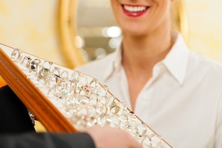 jeweler: Shop assistant at the jeweler with jewelry Stock Photo
