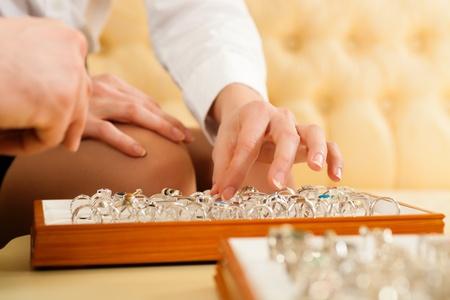jeweler: Couple choosing wedding rings at a jeweller Stock Photo
