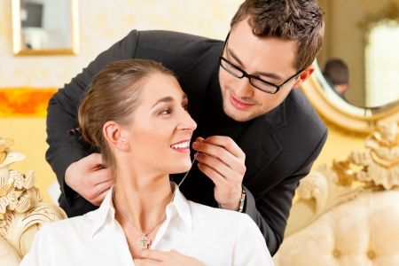 jeweller: Man giving his wife a necklace as a gift