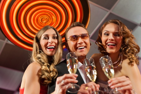 People with champagne in a bar or casino having lots of fun Stock Photo - 11840791