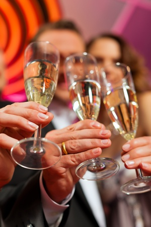 People with champagne in a bar or casino having lots of fun Stock Photo - 11840852