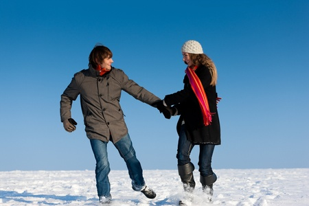 Couple - man and woman - having a winter walk hand in hand photo