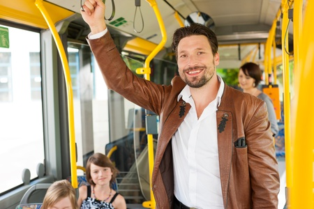 he: Male passenger in a bus; presumably he is heading home Stock Photo