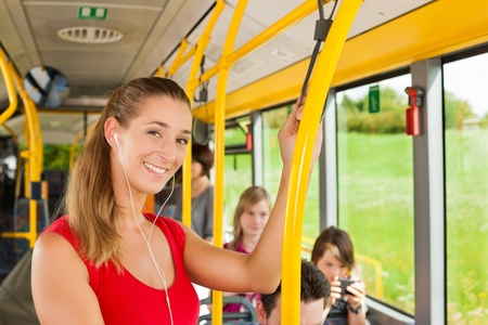 public transport: Female passenger in a bus; presumably she is heading home