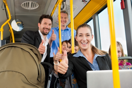 thumps up: Passengers in a bus - a commuter, a father with a stroller, a man, children; all with thumps up Stock Photo