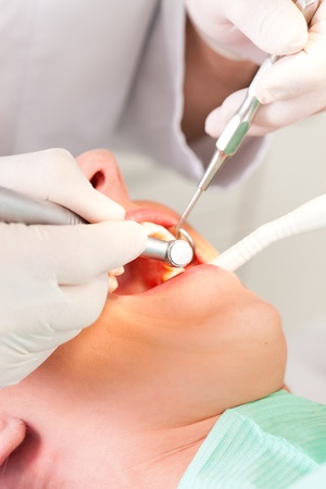 Female patient with dentist in the course of a dental treatment photo