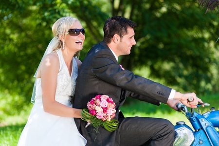 Wedding couple on a motor bike riding in the future photo