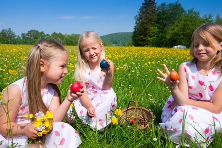 Children on an Easter Egg hunt on a meadow in spring Stock Photo - 11912576