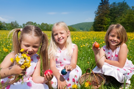 egg hunt: Children on an Easter Egg hunt on a meadow in spring