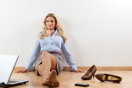 Business woman working at home with her laptop on the floor photo