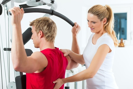 Patient at the physiotherapy making physical exercises with his therapist Stock Photo - 12870656