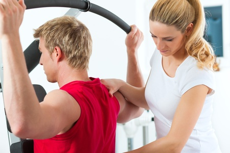 back exercise: Patient at the physiotherapy making physical exercises with his therapist