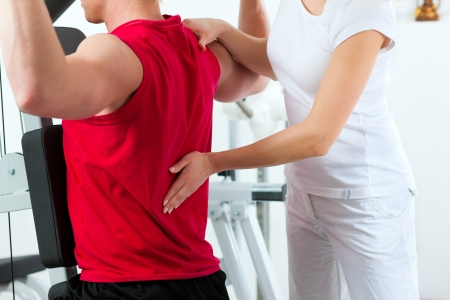 physiotherapist: Patient at the physiotherapy making physical exercises with his therapist