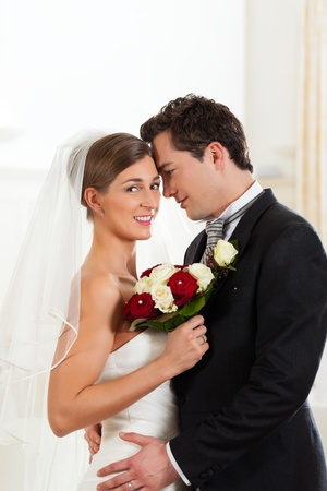 butonniere: Bridal couple on the wedding day deeply in love