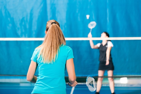 badminton racket: Women playing Badminton and doing sport in gym Stock Photo