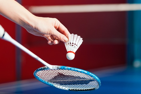 serve: Woman playing Badminton and doing sport in gym, only serve to be seen Stock Photo