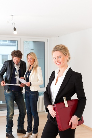 Real estate market - young couple looking for real estate to rent or buy Stock Photo - 12718523