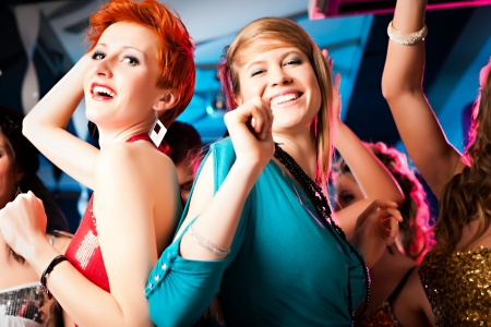 Women or models in club or disco having fun and dancing ecstatically Stock Photo - 12718530