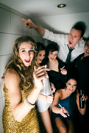 discotheque: People in club and smoking a cigarette in the toilet and have lots of fun