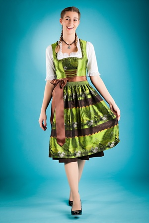 Young woman in traditional Bavarian clothes - dirndl or tracht - studio shoot Stock Photo - 12718825