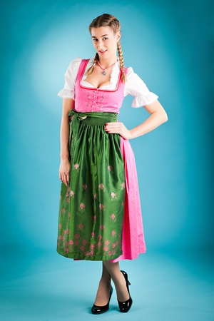 tracht: Young woman in traditional Bavarian clothes - dirndl or tracht - studio shoot