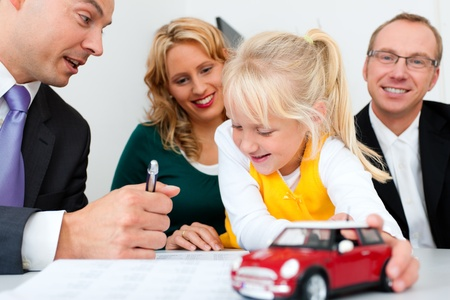financial insurance: Family with their consultant  assets, money or similar  doing some financial planning - symbolized by a toy car they are holding in their hand