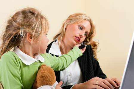 telework: Family Business - telecommuter Businesswoman and mother having trouble  to concentrate on her work while the kid is trying to get some attention - metaphor for the lifestyle choices we all face
