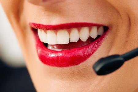 Portrait of a friendly female call center operator Stock Photo - 12721906