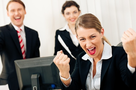 Business people having a lot of fun and letting it show, maybe they are lawyers having won a favorable ruling, maybe they just got notice of their promotion Stock Photo - 12719343