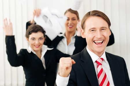 favorable: Business people having a lot of fun and letting it show, maybe they are lawyers having won a favorable ruling, maybe they just got notice of their promotion