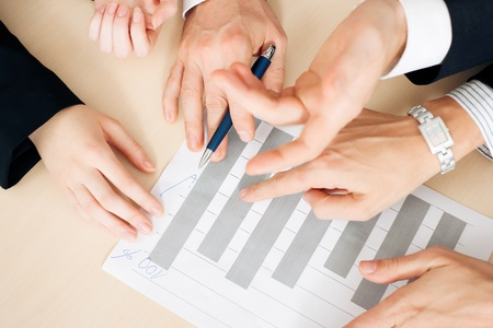 proposal: Group ot three people, only hands to be seen, discussion a business plan for a start-up company, focus on hands Stock Photo