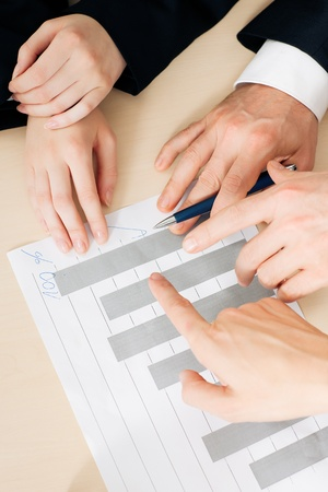 founding: Group ot three people, only hands to be seen, discussion a business plan for a start-up company, focus on hands Stock Photo