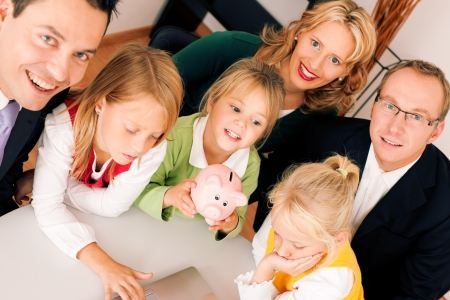 bank protection: Family with their consultant  assets, money or similar  doing some financial planning - symbolized by a piggy bank in the front, the consultant in front looking at the camera