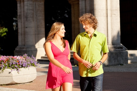 Man and woman in the city – walking on a summer day Stock Photo - 12903440