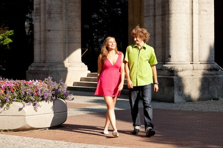 Man and woman in the city – walking on a summer day Stock Photo - 12904746