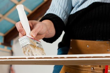 RENOVATE: woman painting Stock Photo