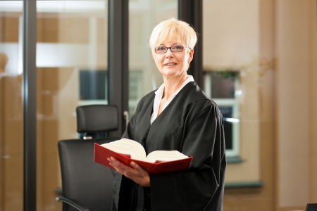 robes: Female lawyer with German civil law code in a court room
